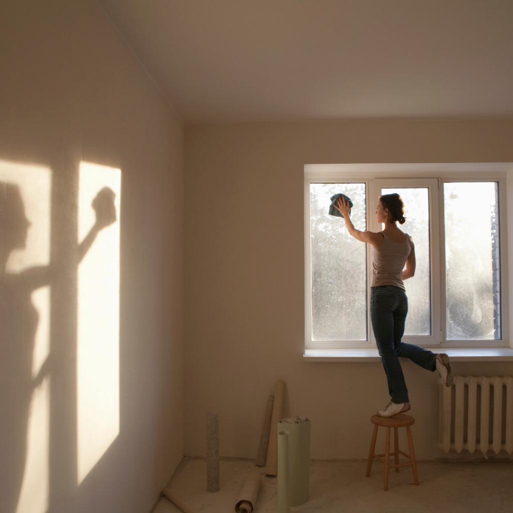 cleaning expert working on residential window