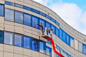 professional window cleaning working on commercial project